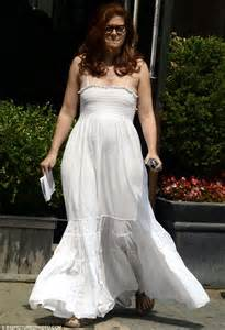 Debra Messing dons flowing white dress to film scenes for