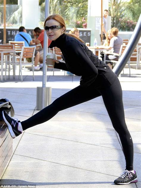 Marcia Cross - stretching in tight pants-01   GotCeleb