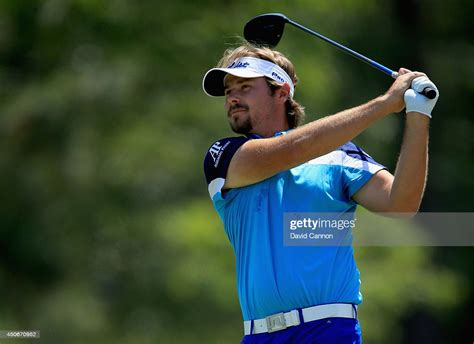 Victor Dubuisson of France hits his tee shot on the second