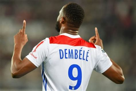 Dembele's late strike gives Lyon victory at 10-man